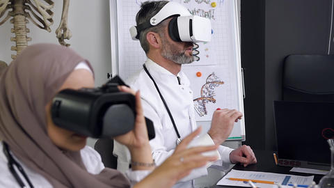 Side view of doctors or scientists which learning medicine in simulation with Live Action