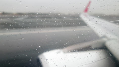 4k video of airplane taking off the wet runway during heavy rain storm Live Action