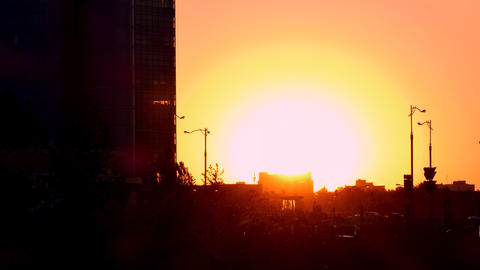 4K Sun Sets on Background of Contrasting Shapes of Urban Buildings Footage
