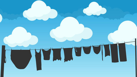 Clothes Hanging to Dry on a Rope on a Blue Sky Background Footage
