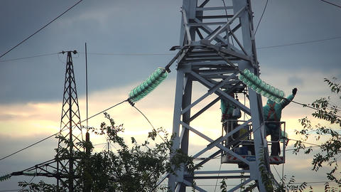 Two man Repair Pylons High Voltage Footage