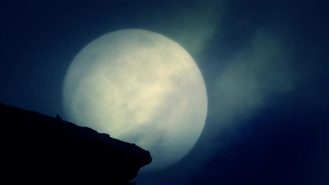 A Cliff at Night on a Rising Full Moon Background on a Spooky Night Live Action