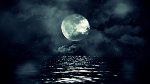 Full Moon with Starry Night Reflecting Above the Water with Clouds and Mist Footage