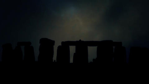 Stonehenge Silhouette at Night Under a Lightning Storm and Rain Live Action