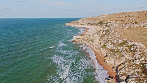 Natural landscape from a bird's eye view The green blue sea with long foamy Live Action