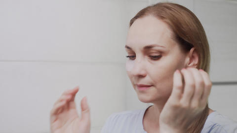 Close up of Adult woman Puts Patches On The Area Under The Eyes Live Action