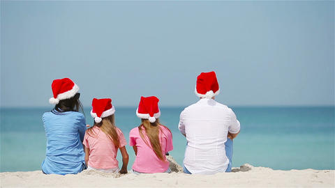 Happy family on the caribbean beach celebrating Christmas vacation Live Action