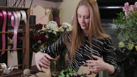 Professional florist makes a bouquet for International Women's Day Live Action