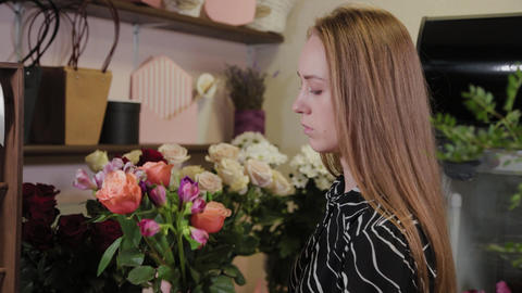 Professional florist collects a composition of flowers. Beautiful bouquet for Live Action