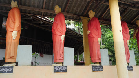 4k dolly video of buddhist monks statues standing in row at the buddhist temple Live Action