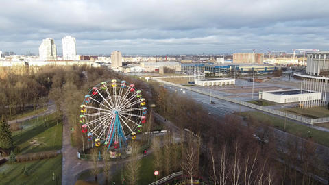 Aerial view of Gagarin Park and amusement park near Victory Park Pobedy in Saint Live Action