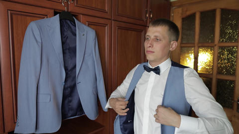 Handsome groom wearing a jacket. Wedding morning. Businessman Live Action