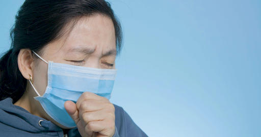 woman wear mask having cold and coughing Live Action