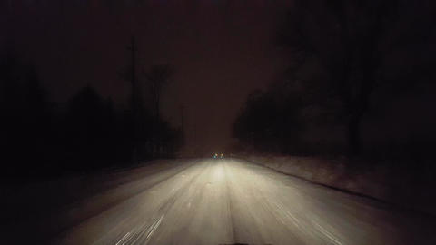 Driver Slips on Slippery Dangerous Road in Snow Blizzard on Rural Road at Night. Driver Point of Live Action