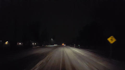 Driver Approaching Traffic Accident While Snowing on Rural Road at Night. Driver Point of View POV Live Action