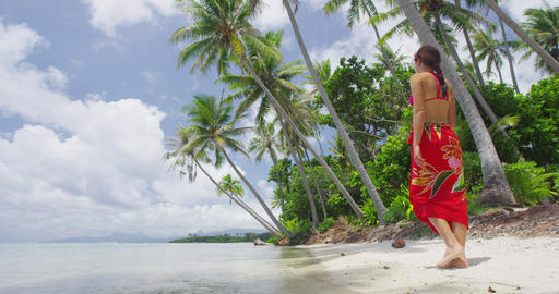 Vacation Travel woman walking on paradise beach in Bora Bora French Polynesia Live Action