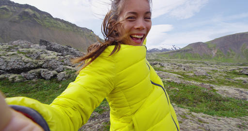 Woman taking selfie video happy and excited cheering full of joy on Iceland Live Action