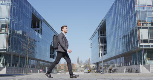 Business man - Young urban professional businessman walking to work Live Action