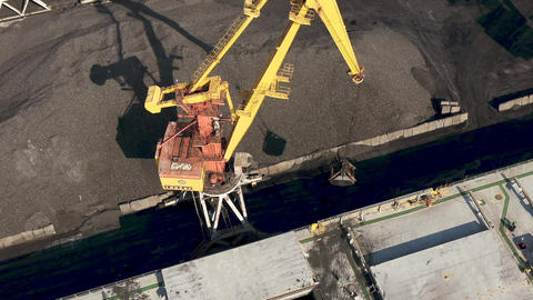 VENTSPILS, LATVIA - JULY, 2019: Aerial view of port crane that loads cargo into Live Action