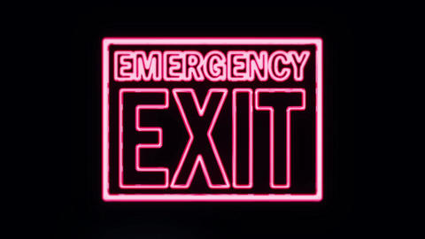 Neon Emergency Exit Sign Lighting Up Footage