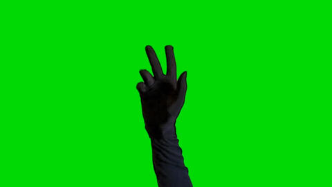 Hand Wearing Black Glove in the Air on a Green Screen Background Footage