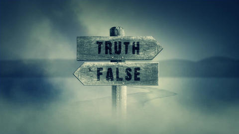 Old Wooden Sign on a Middle of a Cross Road With the Words Truth or False Footage