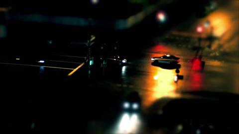 1080p Miniature Tilt-Shifted Car Makes U-Turn at Crossroads of Night Footage