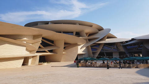Exterior of Qatar National Museum. Modern Architecture and Landmark of Doha City Live Action