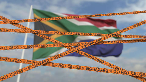 Caution biohazard tape with flag of South Africa as a background. South African Live Action