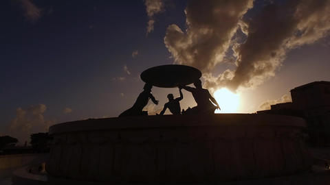 Valletta, Malta, Triton Fountain Sculpture Silhouette From Sunset Sunlight Live Action