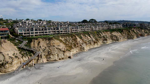 Aerial view of condo community next to the beach and sea in south california Live Action