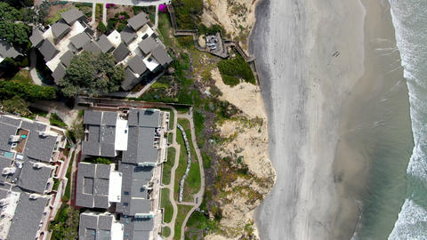Aerial top view of condo community next to the beach and sea in south california Live Action