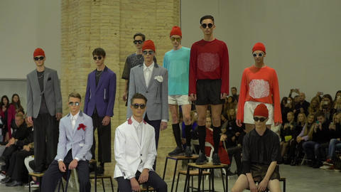 Fashion show. Male model walking on the catwalk. Slow motion Live Action
