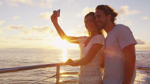 Cruise ship - Romantic couple taking selfie at sunset small cruise ship Live Action