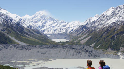 New Zealand Mt Cook Hikers looking at view - People hiking relaxing in nature Live Action