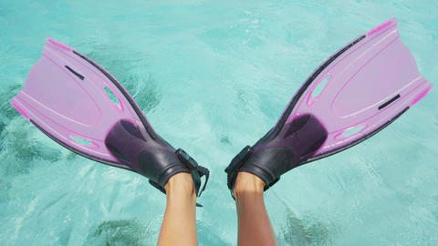 Woman swim snorkel feet playful having fun with pink fins over ocean beach Live Action