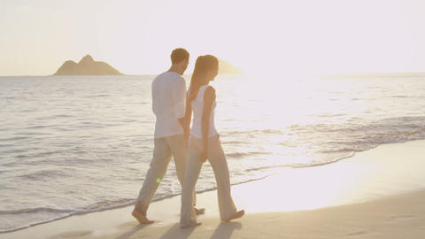 Travel vacation beach couple walking enjoying sunset on vacation Live Action