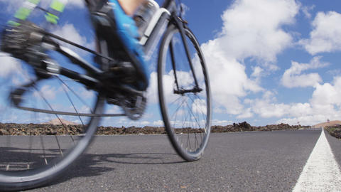 Road bike cyclist sports athlete biking cycling outdoors closeup Live Action