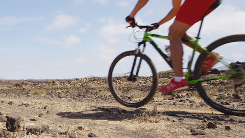 Man mountain biking on MTB bike cycling trail Live Action