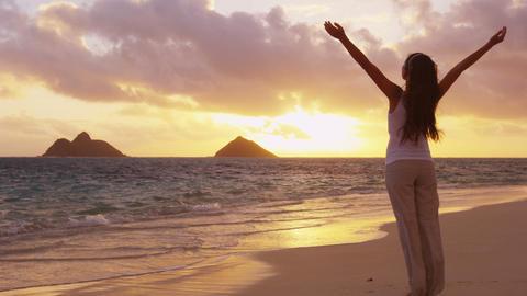 Serene happy woman enjoying nature sunset raising arms to sky enjoying freedom Live Action