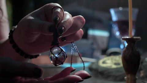 The sorceress holds in her hands a crystal ball. Conducts a spiritualistic Live Action