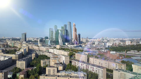 Moscow city skyscrapers through sun rays. International business center of Live Action