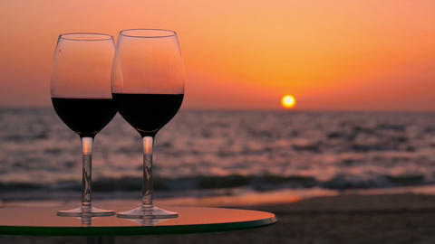 Glasses of Wine on a Table Against the Sea Live Action