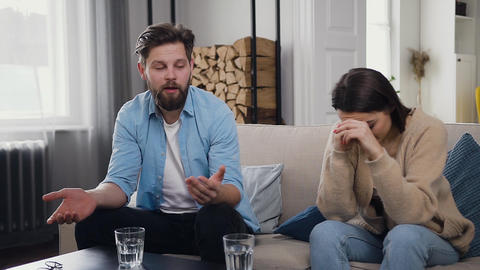 Nervous young bearded man telling about his problems in family relationships Live Action