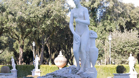The statue and fountain in the Villa Borghese gardens, Rome, Italy Footage