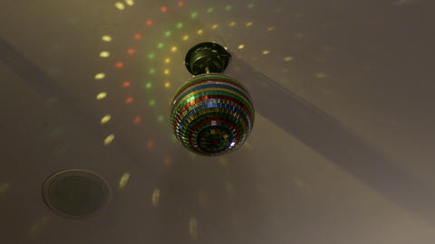 4K Ungraded: Disco Ball Rotates, Casting Colorful Beams of Light on Ceiling Footage