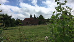Looking through an English hedge towards Sissinghurst Castle gardens Footage