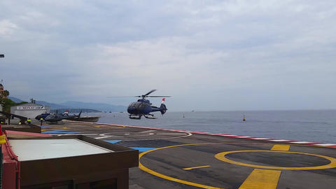 Helicopter Landing on the Platform Above the sea in Monaco Footage