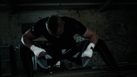 Man stretches his legs fitness sport crossfit Footage