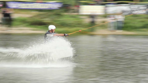 Wake board professional riding track by cable jumps trampoline Footage